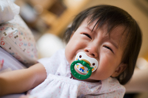 Crying Baby --- Image by © Ken Seet/Corbis